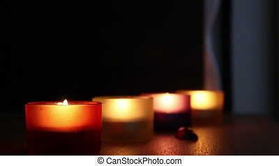 Four glass with candles