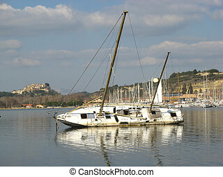 beached wreck sailboat - a beached wreck sailboat in...