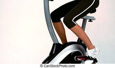 Fit woman on the exercise bike