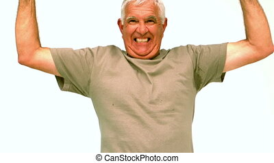 Elderly man jumping and cheering