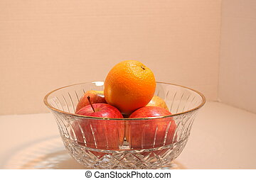 Fruit in crystal bowl - Apples and an orange in a crystal...
