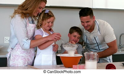 Parents baking with their children in slow motion