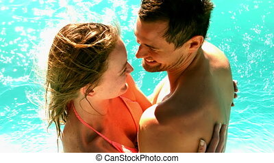 Sexy couple standing in the pool