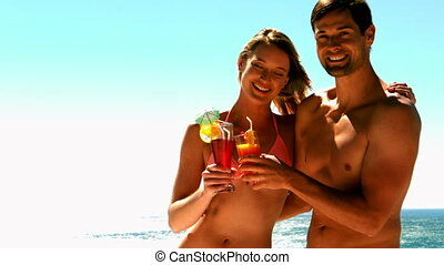 Sexy couple having cocktails together on holidays in slow...