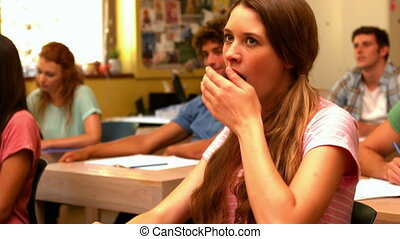 Student yawning in classroom in slow motion