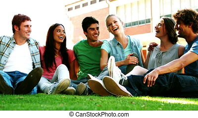 Happy students chatting together