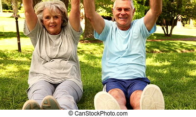 Retired couple exercising together