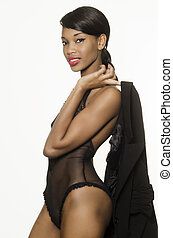 Beautiful African American model in lingerie isolated...