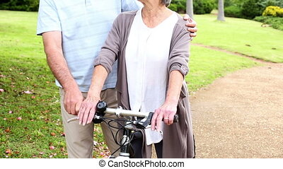 Retired couple standing in the park