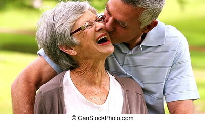 Affectionate senior couple in the park