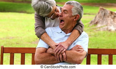 Affectionate senior couple in the park on a sunny day
