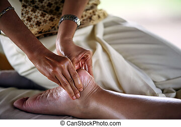 Massage of legs - A detail image of a female leg being...