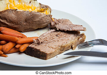 Pot Roast with Carrots and potato. - This is a photograph of...
