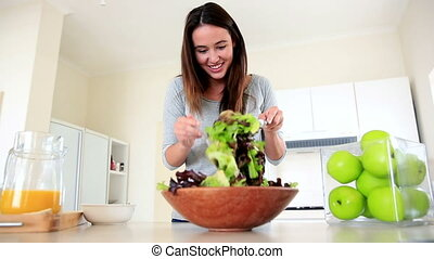 Pretty brunette preparing a healthy