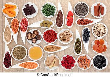 Super Food - Healthy super food selection over oak wood...