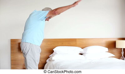 Senior man doing exercises in the morning at home in the...