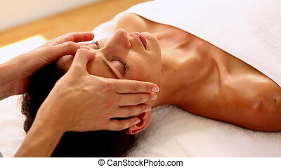 Woman getting a massage - Woman getting a massage in therapy...