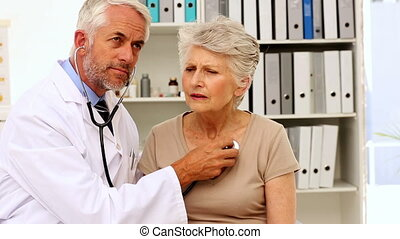 Doctor listening to patients chest