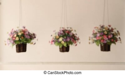 Three flower pots, Fake flowers plastic mounted in the side...