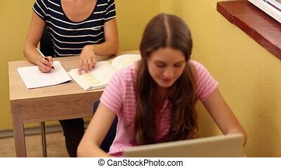 Student smiling up at camera