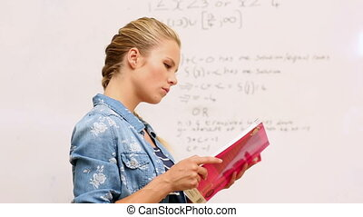 Focused student look at math on whiteboard in classroom at...