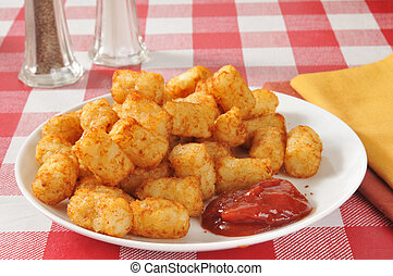 Tater tots - A plate of deep fried tater tots with catsup