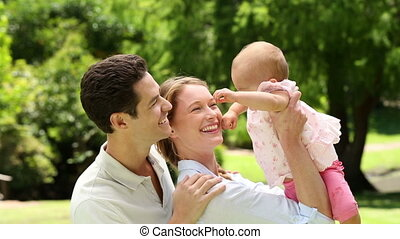 Happy parents with their baby girl - Happy parents with...