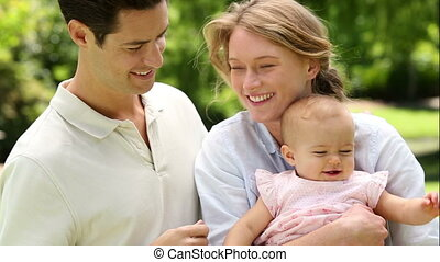 Happy parents with their baby girl