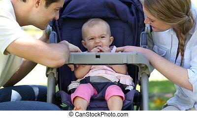 Happy parents tending to baby girl