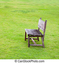 Wood chair on Green Grass Out Door
