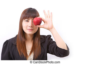 Beautiful young woman eating red apple with health teeth