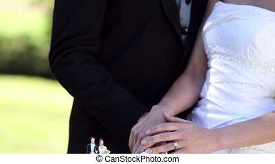 Happy newlyweds cutting their cake - Happy newlyweds cutting...