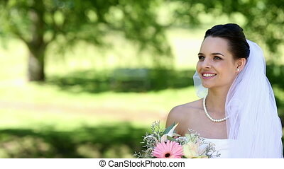 Beautiful bride smiling at camera - Beautiful bride smiling...
