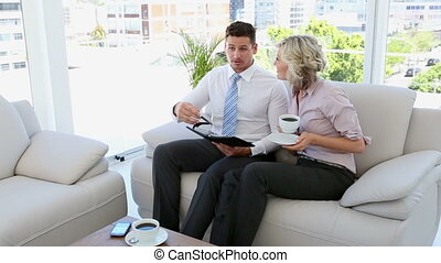 Business people working together on the sofa