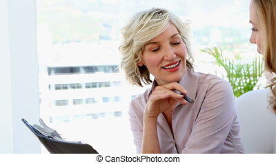 Businesswomen planning together - Businesswomen planning...