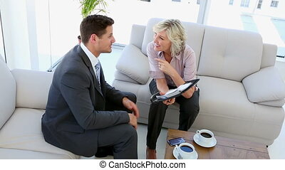Business people working together sitting on sofa