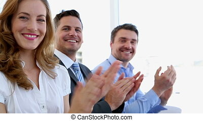 Business people clapping in the office