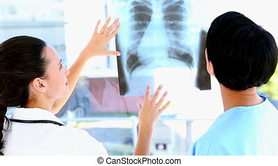 Doctor and nurse discussing xray in office at the hospital