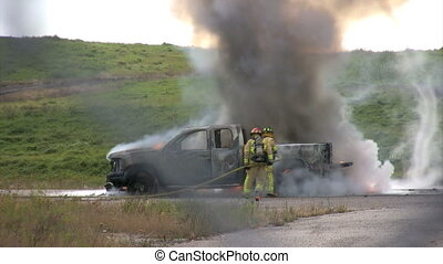 Firemen - firefighters douse burning truck