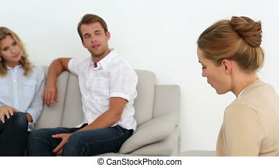 Couple talking with their therapis