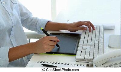 Casual graphic designer working at - Casual graphic designer...