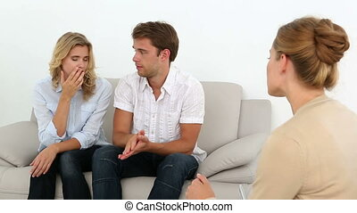 Couple talking with their therapist at therapy session