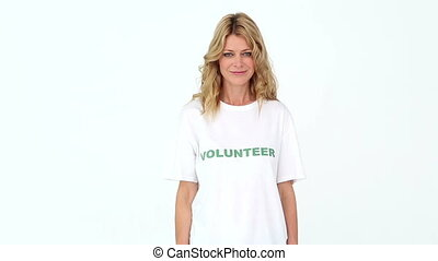 Pretty volunteer pointing to camera on white background