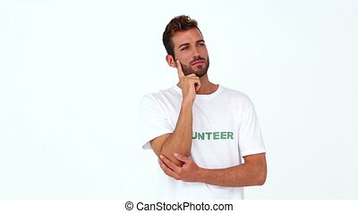 Handsome volunteer thinking on white background