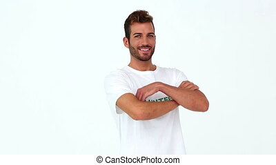 Handsome volunteer smiling at the camera on white background...