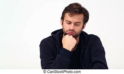 Depressed young man - Depressed young man on white...