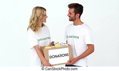 Two volunteers holding a donations box on white background