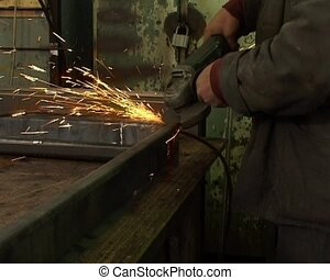 metal grinding - the worker make metal grinding work in...