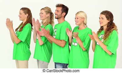 Team of environmental activists clapping on white background...
