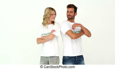 Two volunteers smiling at camera on white background